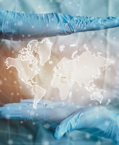 Worldwide healthcare concept with doctor and map. Close up.